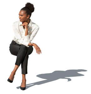 cut out businesswoman sitting outside in the sunlight