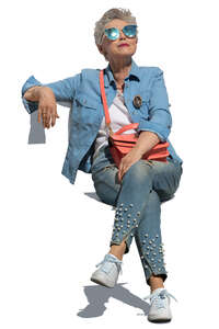 cut out trendy elderly woman sitting on a chair and relaxing