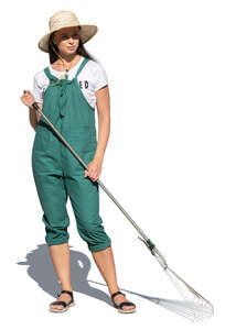 cut out woman with a rake working in a garden