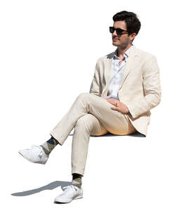 cut out man in a white suit sitting