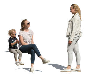 cut out woman and a child sitting and talking to woman standing beside them