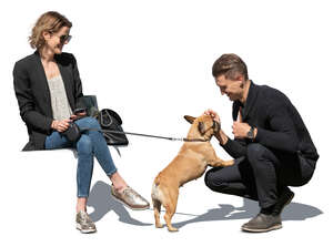 cut out man and woman sitting and petting  a small dog