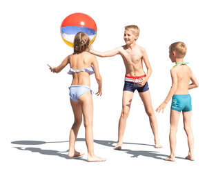 three cut out kids playing with a ball at the beach