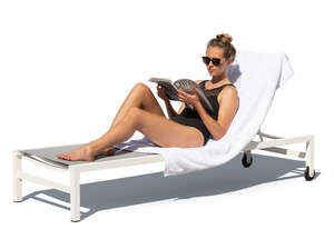 woman lying on the beach chair and reading