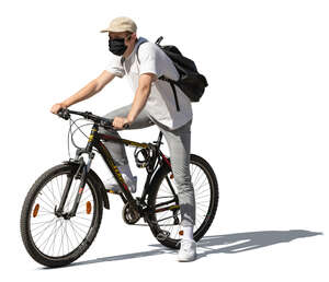 cut out young man with a face mask riding a bike