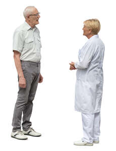 cut out elderly man standing and talking to a doctor