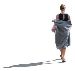 cut out backlit woman with a grey summer overcoat walking