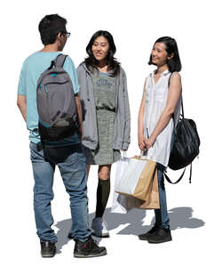 cut out three young asian people with shopping bags standing and talking