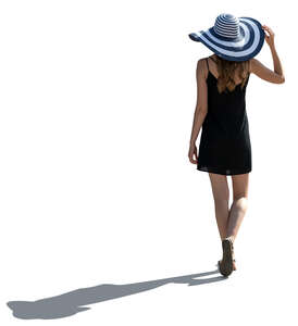 cut out backlit woman with a large striped hat