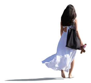 cut out woman in a white dress walking barefoot