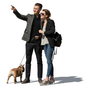 couple with a dog standing and looking at smth