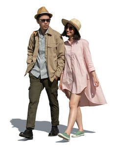 cut out young couple walking arm in arm on a summer day