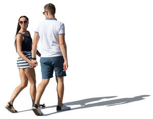 cut out man and woman walking and holding hands