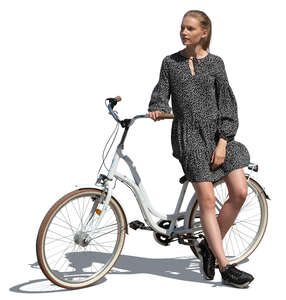 cut out young woman standing and leaning on her bicycle