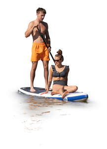 cut out man and woman riding a sup board