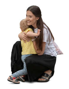 cut out  woman squatting and hugging her son