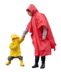 mother and son in raincoats standing hand in hand