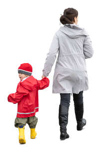 cut out mother and son walking hand in hand on in autumn