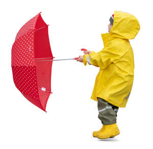 cut out child in a yellow raincoat standing and holding a red umbrella on a windy day