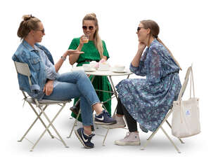 three cut out young women sitting in a cafe and talking