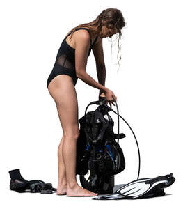 cut out woman standing and packing her diving gear