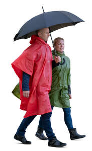cut out man and woman wearing raincoats walking under un umbrella