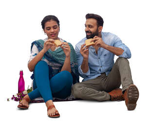 cut out indian man and woman sitting and eating sandwiches