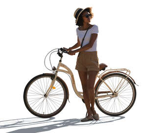cut out backlit black woman with a bicycle standing