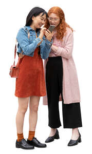 two cut out women standing and looking at a phone together