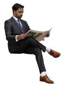 cut out indian businessman sitting and reading a newspaper