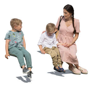 cut out woman and her two sons sitting and talking