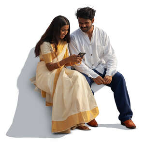 cut out indian man and woman sitting and watching smth from a phone together