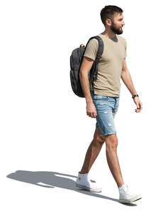 cut out young man walking on a sunny day