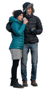 cut out couple in winter clothes standing outside and drinking coffee