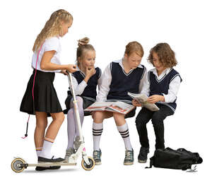 cut out group of school children sitting and reading