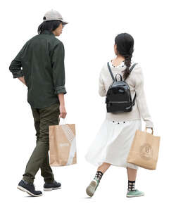 man and woman with shopping bags walking and talking