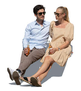 cut out man and woman sitting and drinking soft drinks
