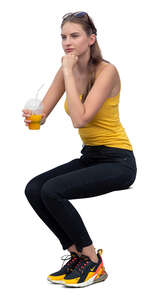 cut out woman sitting and drinking smoothie