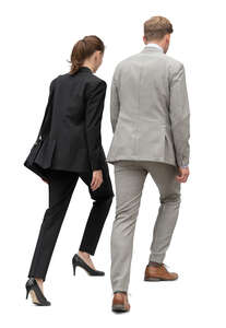 cut out businessman and businesswoman walking up the stairs