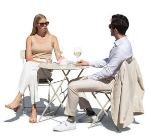 cut out man and woman sitting in a street cafe and drinking wine
