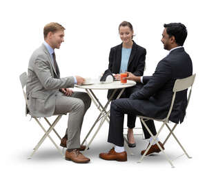 three cut out businesspeople having a business meeting in a cafe