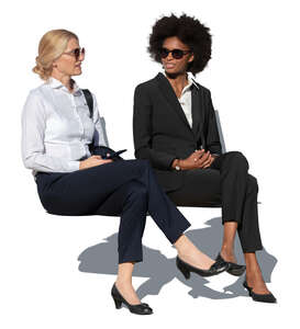 two businesswomen sitting and talking