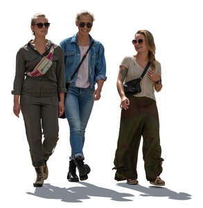 three cut out backlit women walking and talking cheerfully