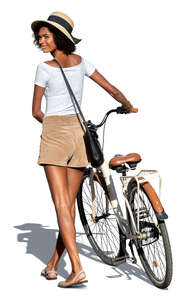cut out woman with a bicycle walking and looking back over her shoulder