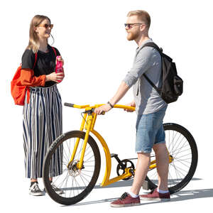 man with a yellow bike talking to a woman