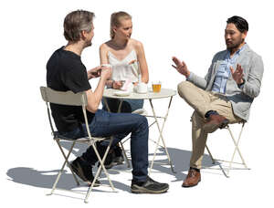 cut out group of three people sitting in a cafe and talking
