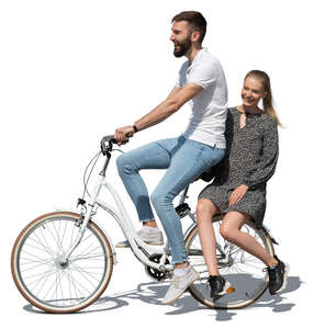 man riding a bike with a woman sitting on the rack