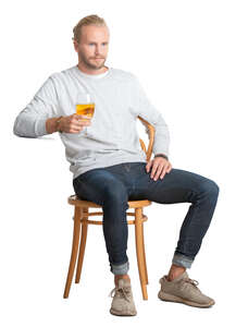 cut out man sitting and drinking beer