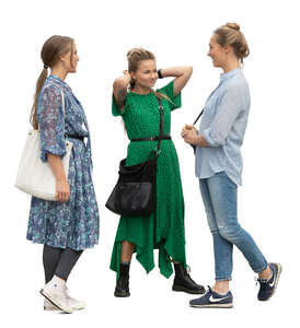 three cut out women standing and talking