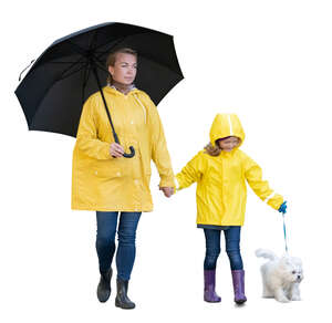 cut out mother and daughter and a dog walking in the rain